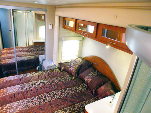 Above is the view looking down on the full size queen bed from the